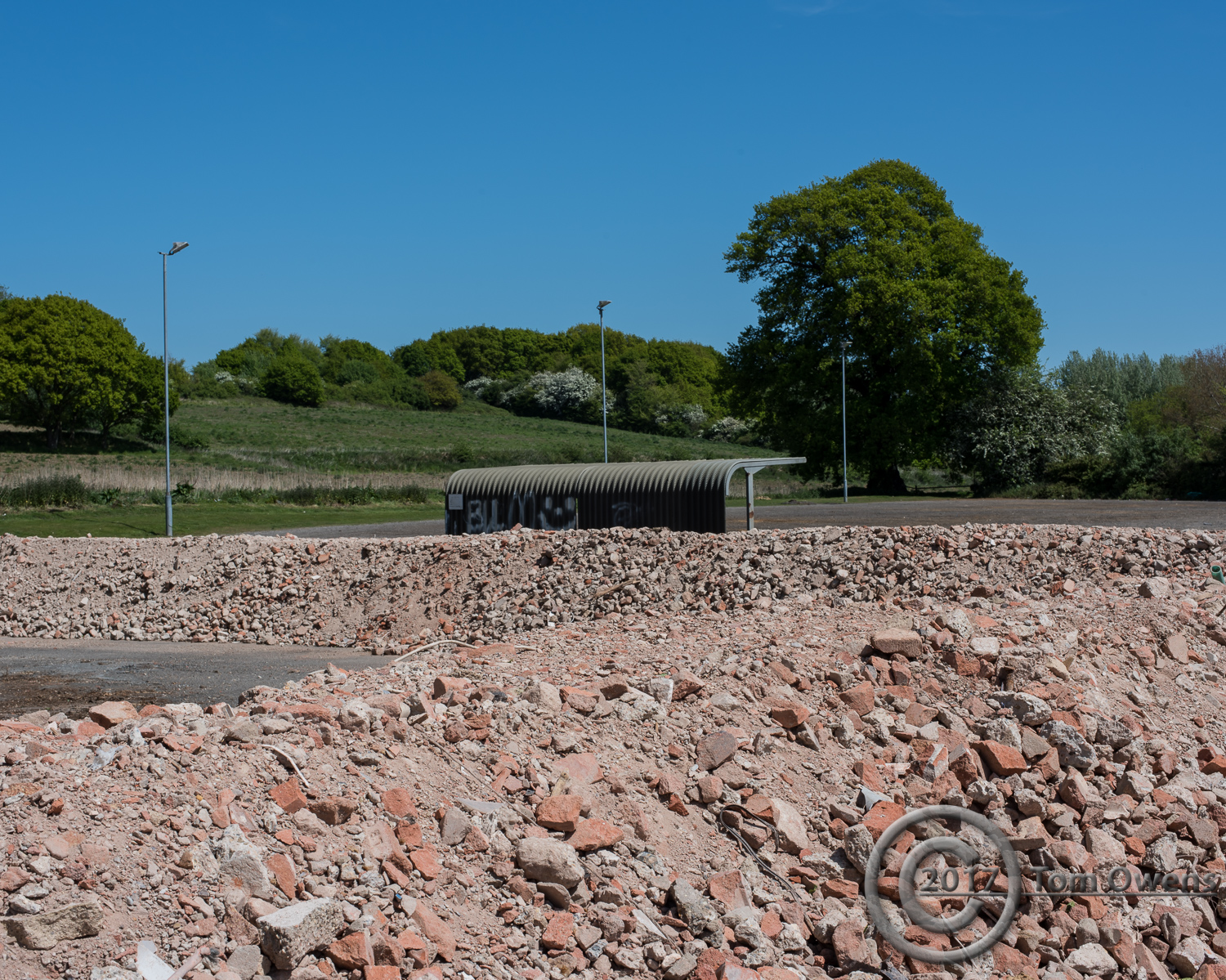 Rubble bunds with inaccessible bike shed
