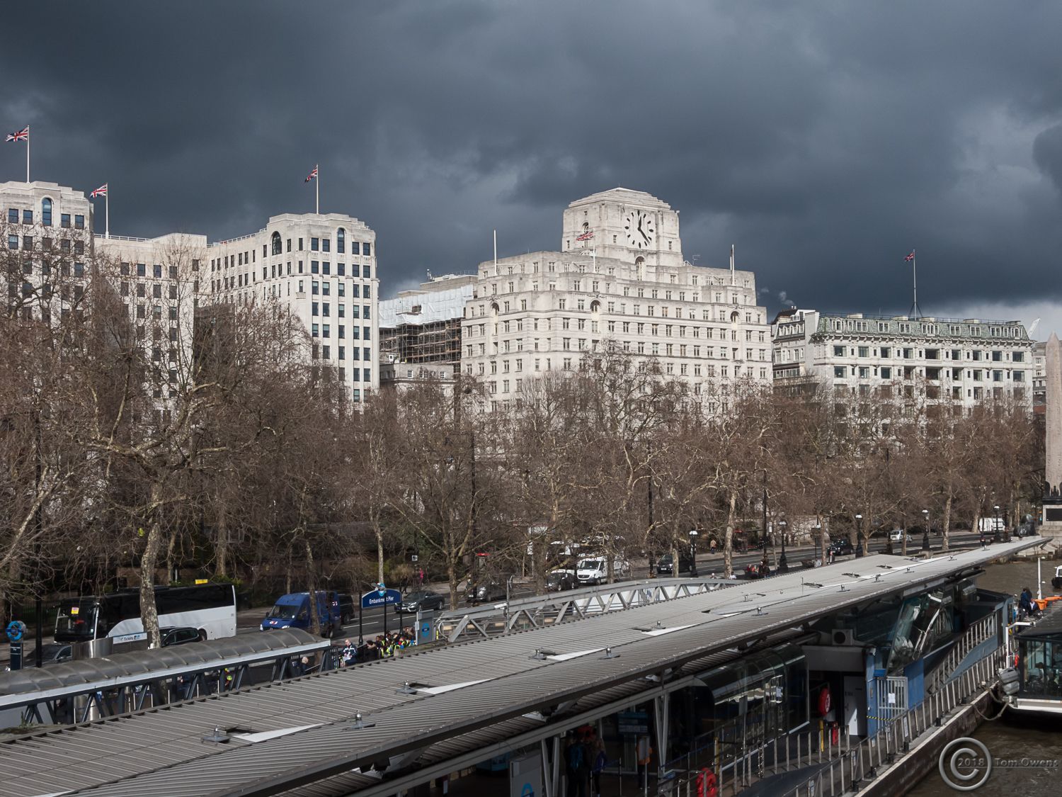 Embankment grey clouds white buildings and union flags