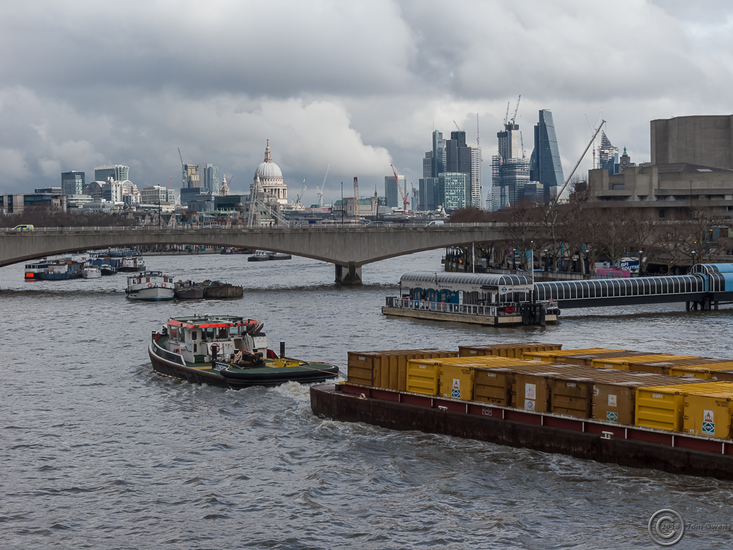 Waste barges being towed down the Thames