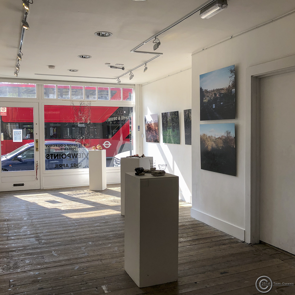 inside of gallery with London bus outside