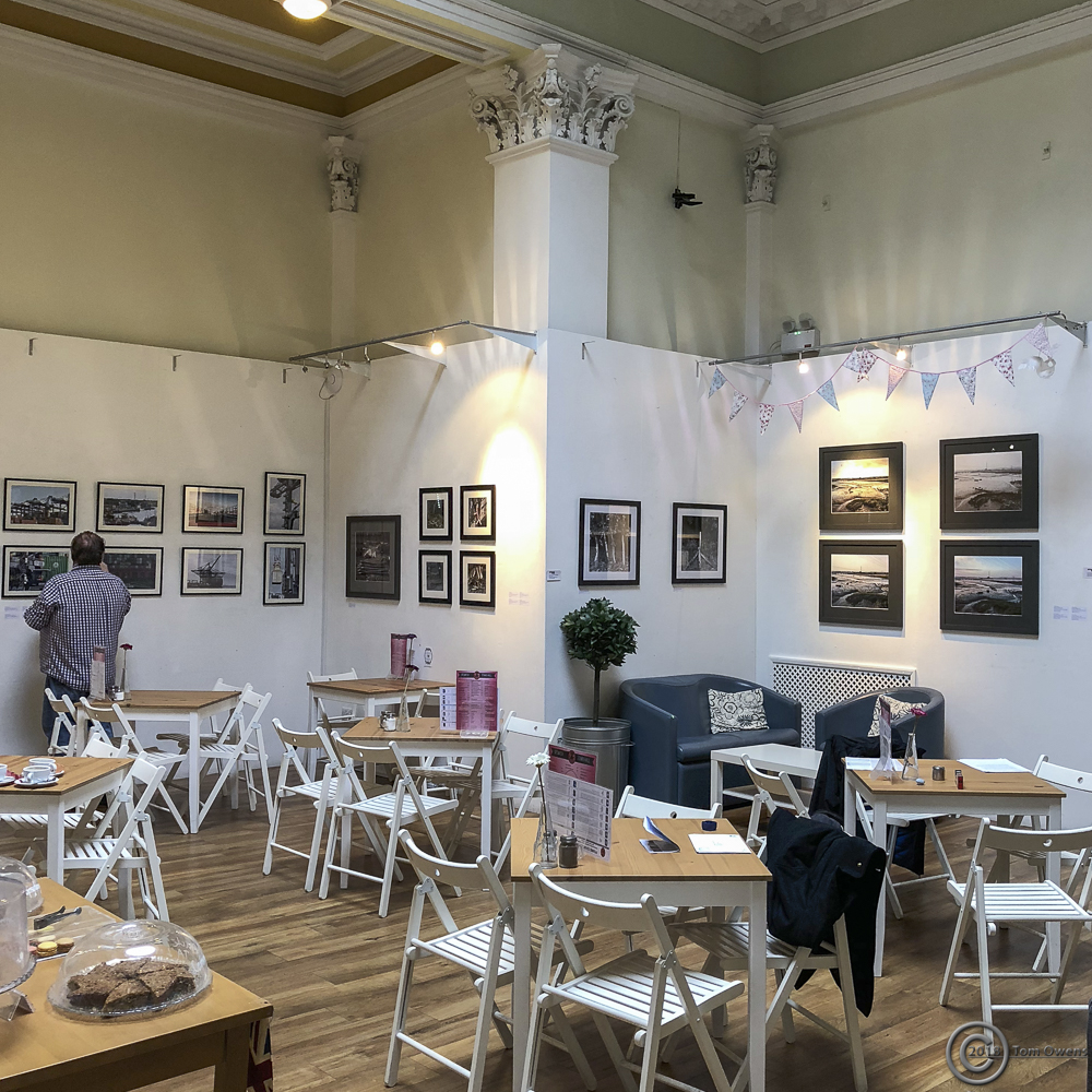 Coffee shop gallery with MEUS artwork