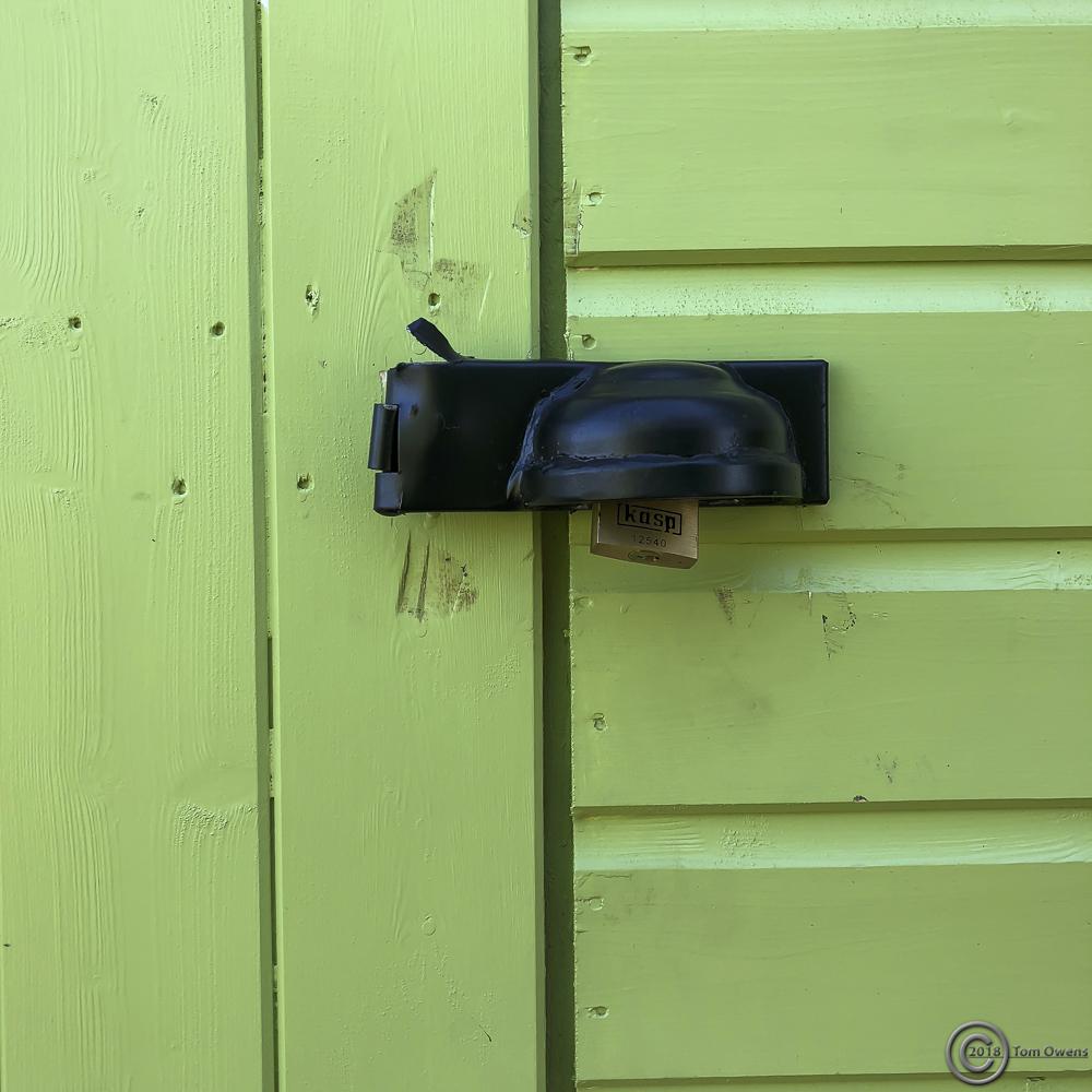 Damaged padlock protector